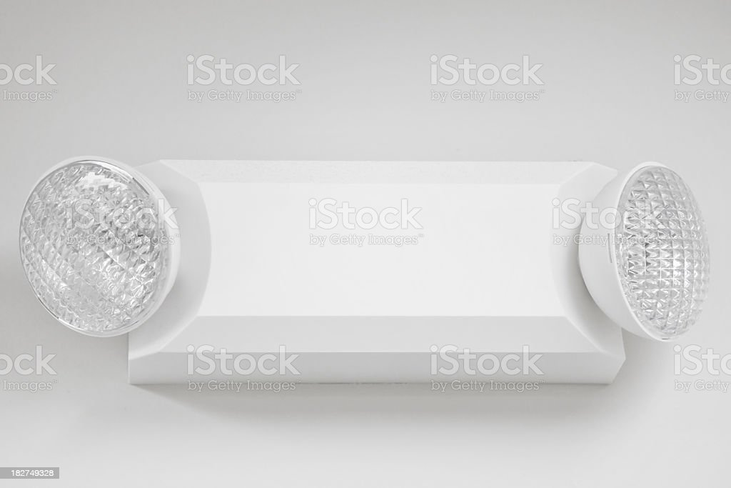A white emergency light on a white wall royalty-free stock photo