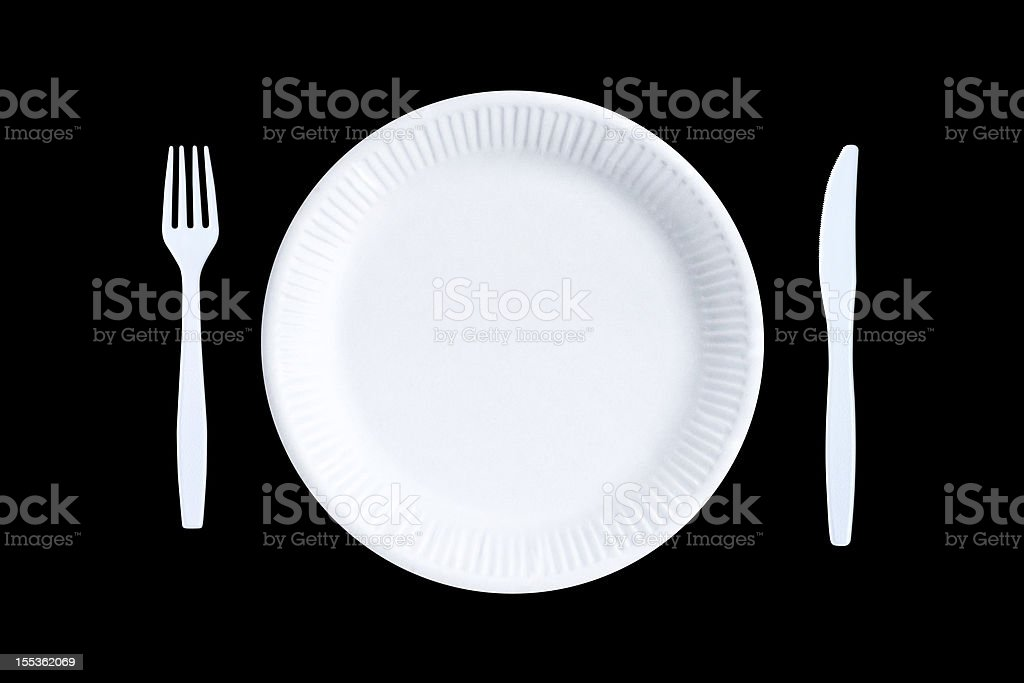 White empty paper plate and white plastic cutlery, black background stock photo