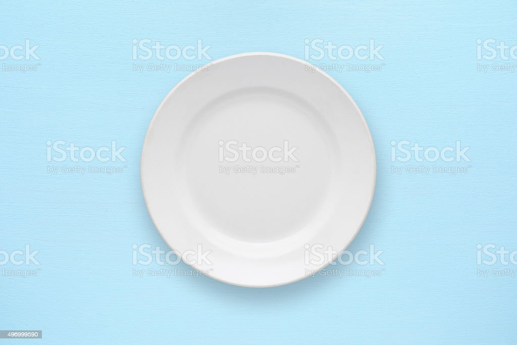 White empty plate on table stock photo