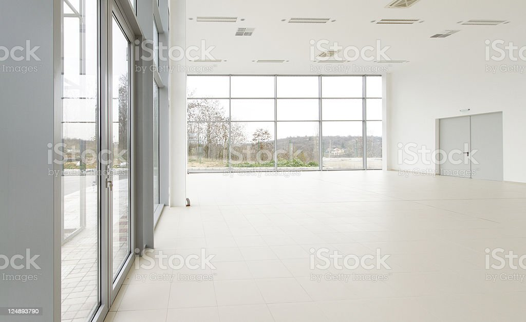 White empty room with big glass doors and windows stock photo