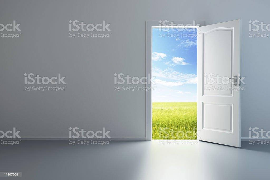 white empty room with opened door stock photo