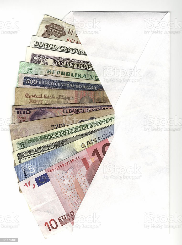 White envelope with international currencies stock photo