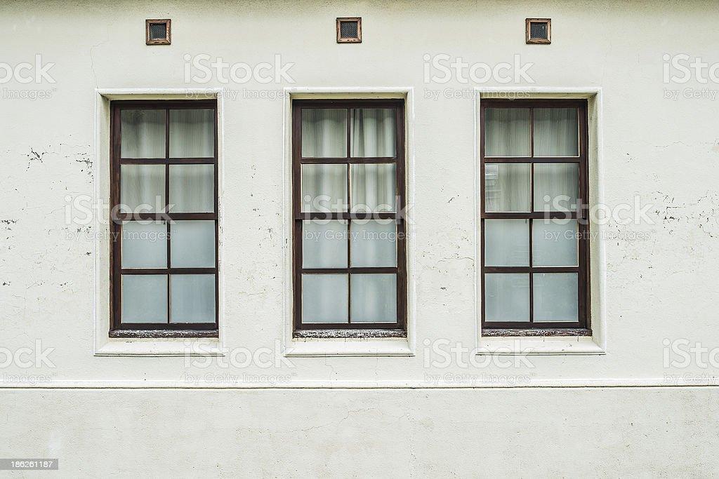 white facade with windows royalty-free stock photo