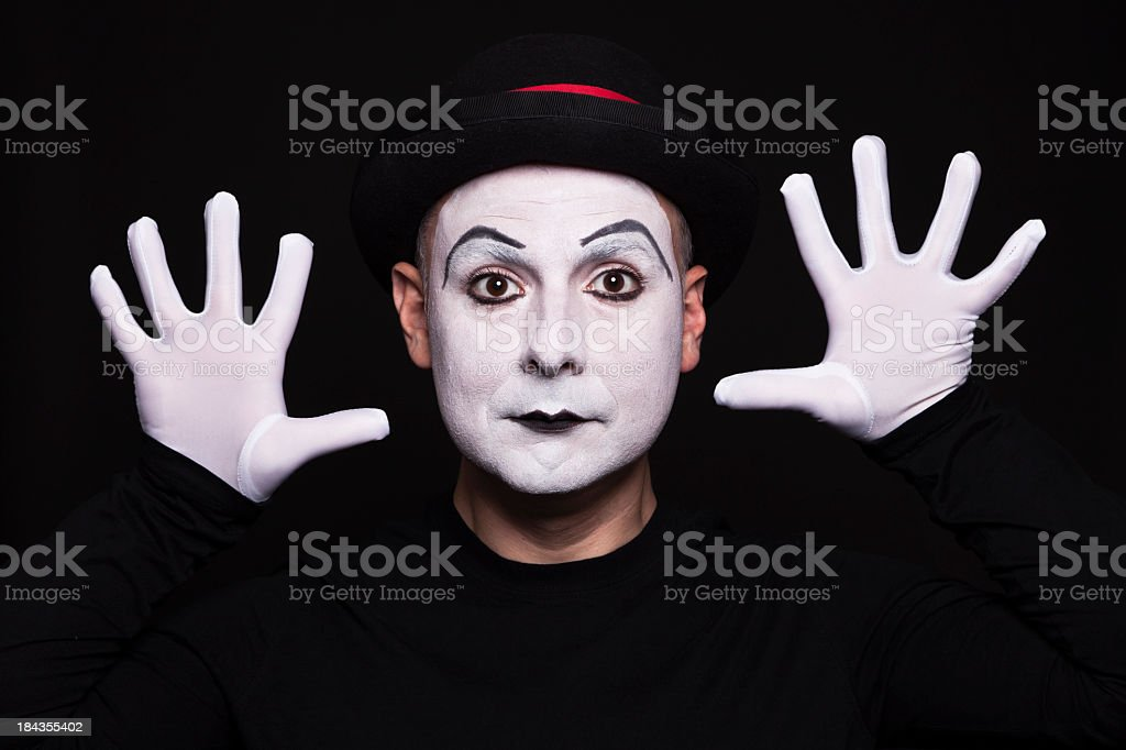 White face mime acting out moves stock photo