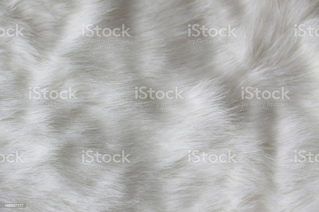 white faux fur as an abstract background stock photo