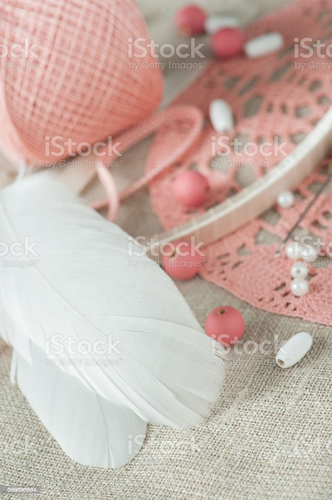 White feathers, pearls, pink beads stock photo