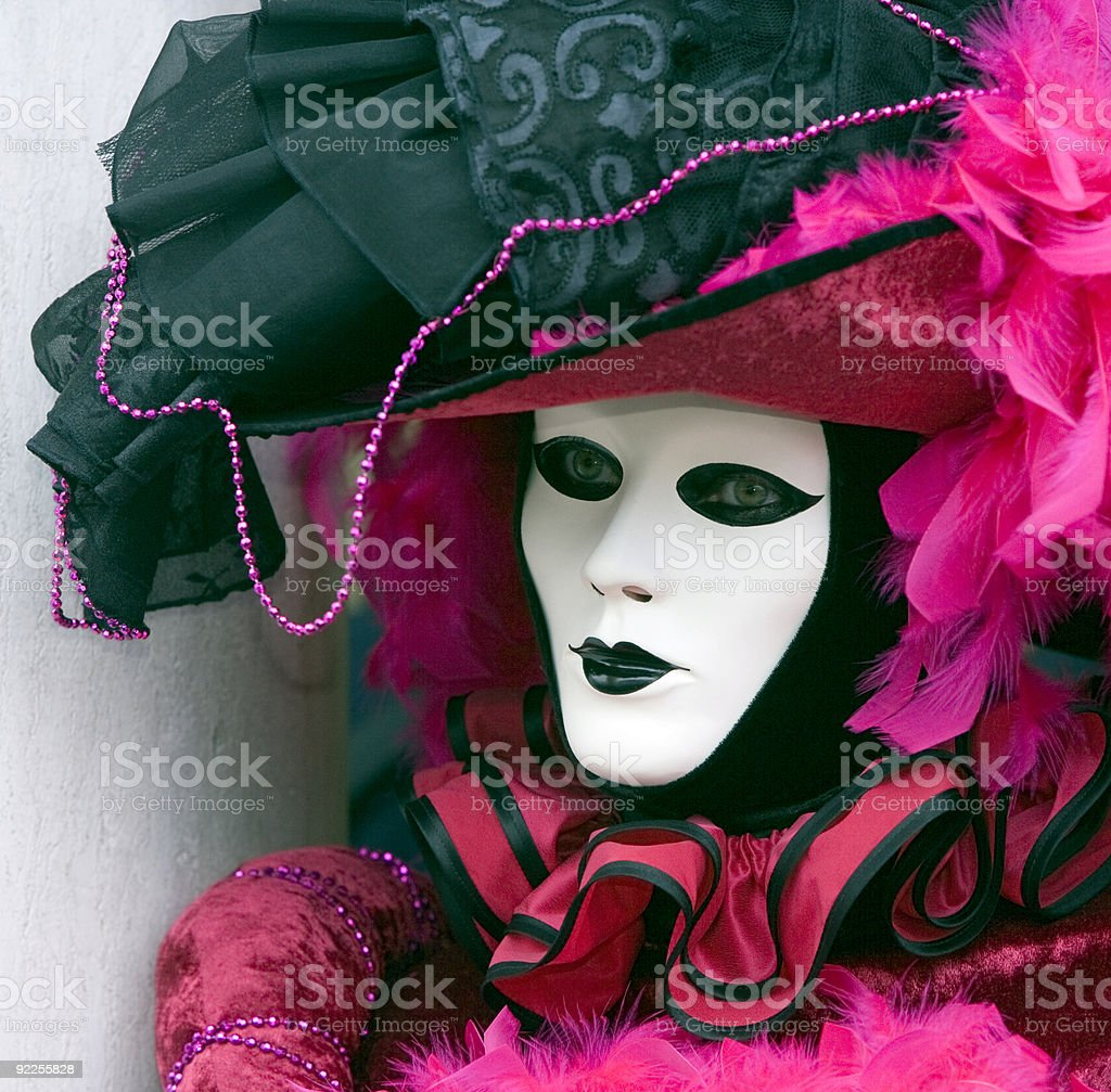 White female mask with beautiful costume at carnival in Venice royalty-free stock photo