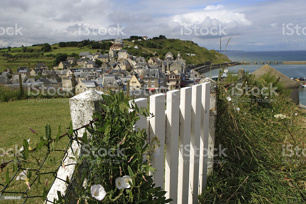 white fence on the cliffs of Port-en-Bessin stock photo