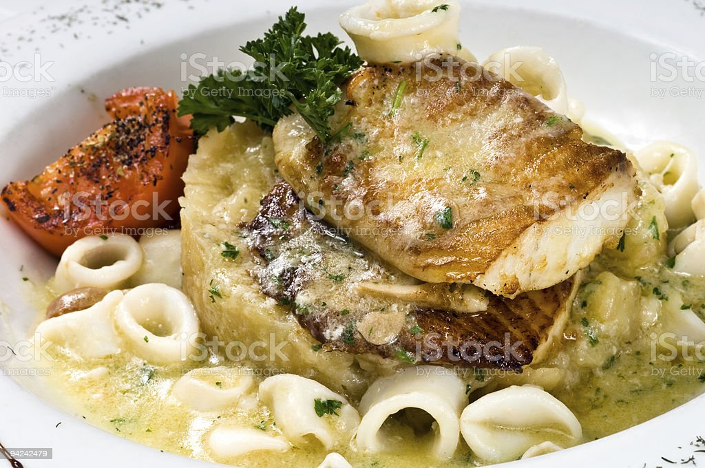 White Filet of Fish with Calamari (merluza con calamares) royalty-free stock photo