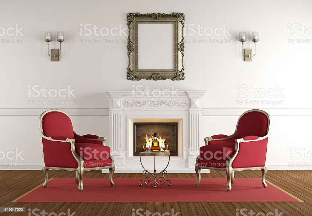 White fireplace in a classic living room stock photo