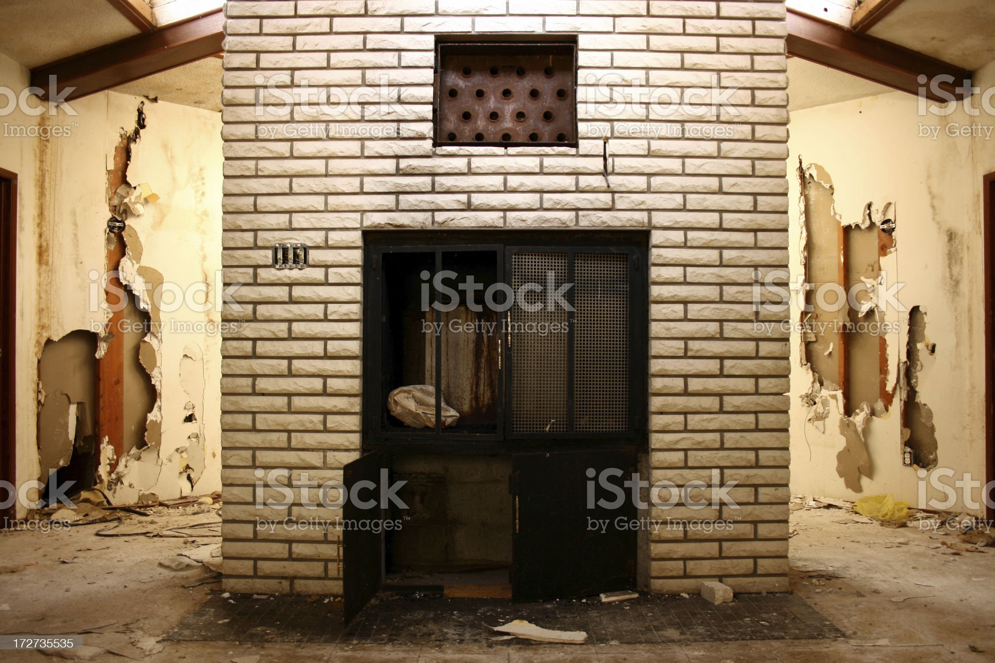 White fireplace in center of octagonal room royalty-free stock photo