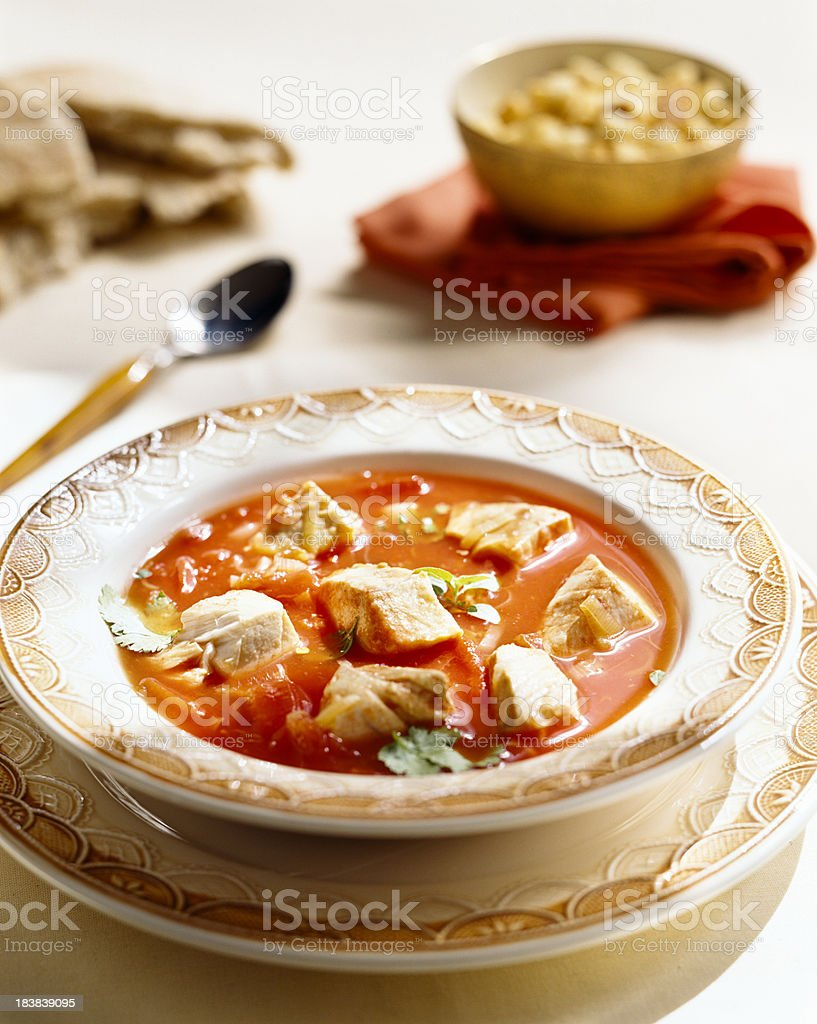 White fish and tomato soup stock photo