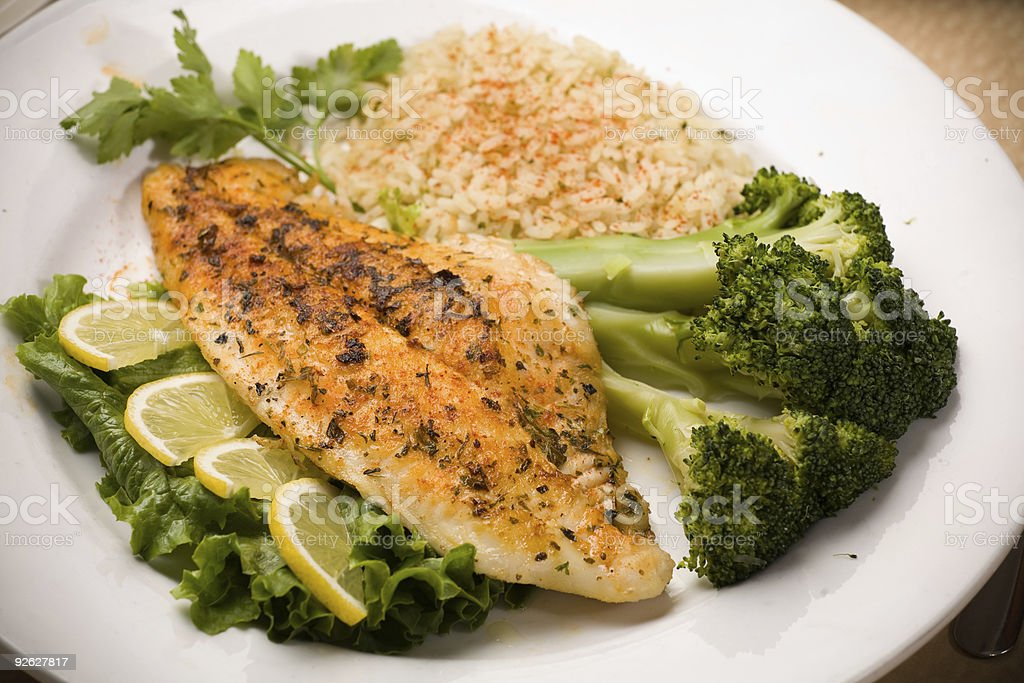 White Fish Fillet with Broccoli Spears stock photo