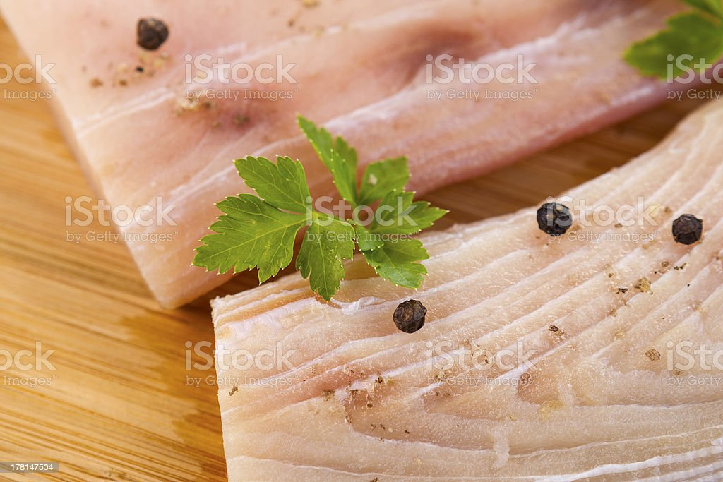 White Fish Fillets Seasoned for Cooking royalty-free stock photo