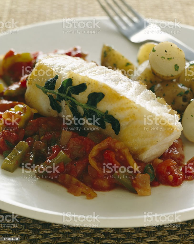 White fish with  rustic tomato sauce royalty-free stock photo