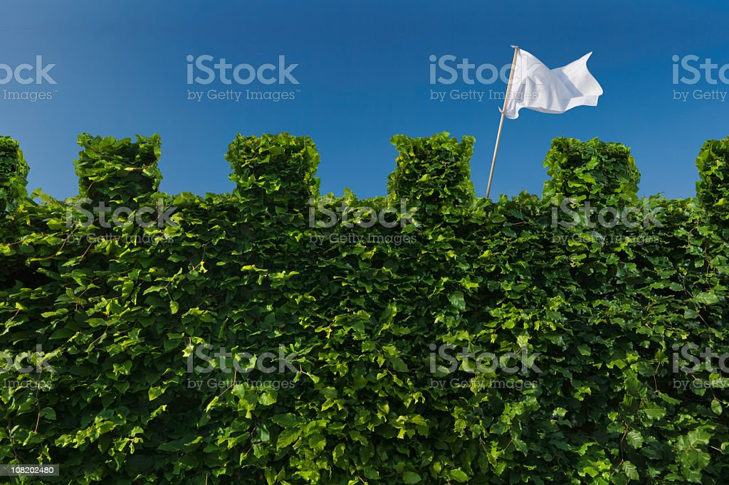 White Flag Raised above Turret Hedge stock photo
