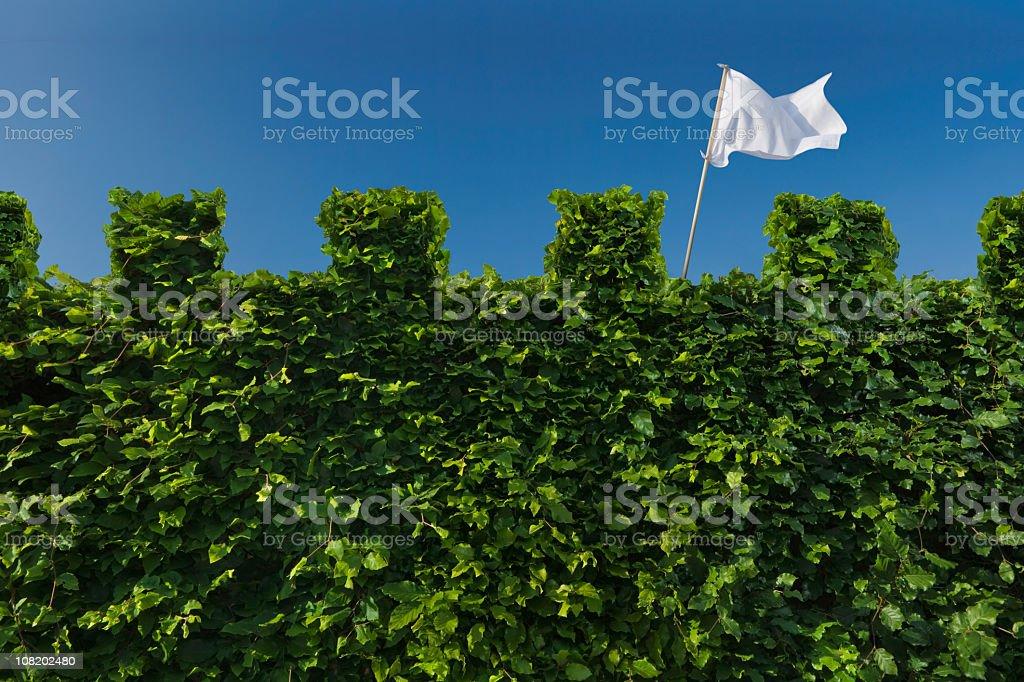 White Flag Raised above Turret Hedge stock photo