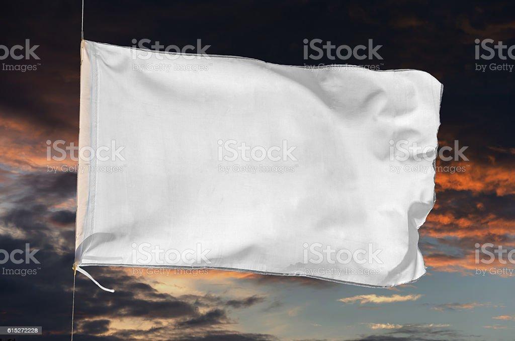 white flag waving on the storm stock photo