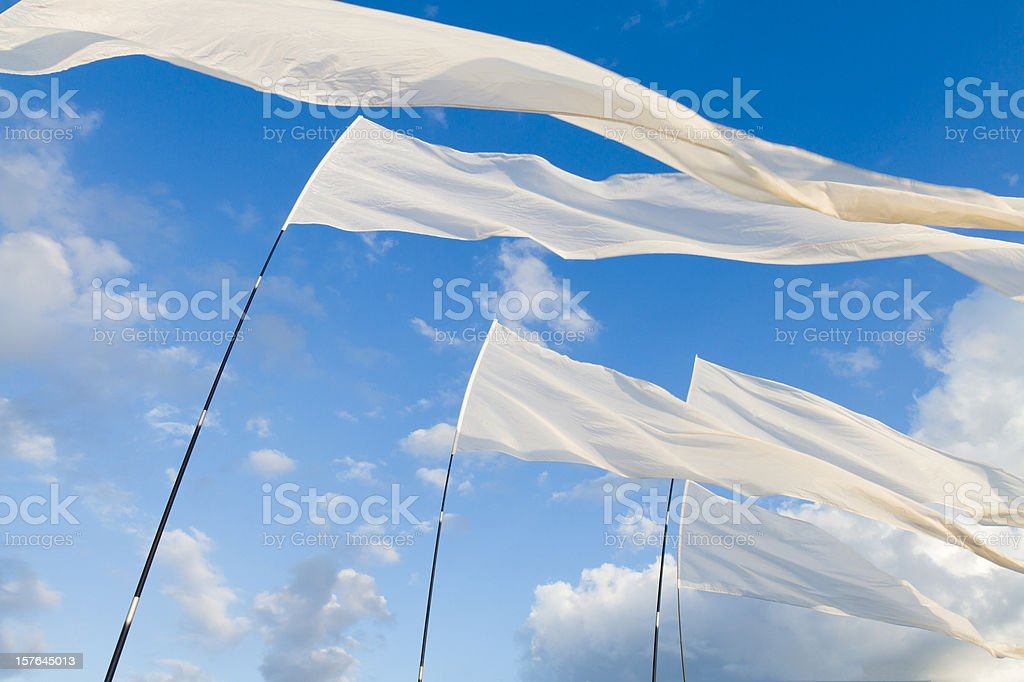 White Flags against blue Sky stock photo