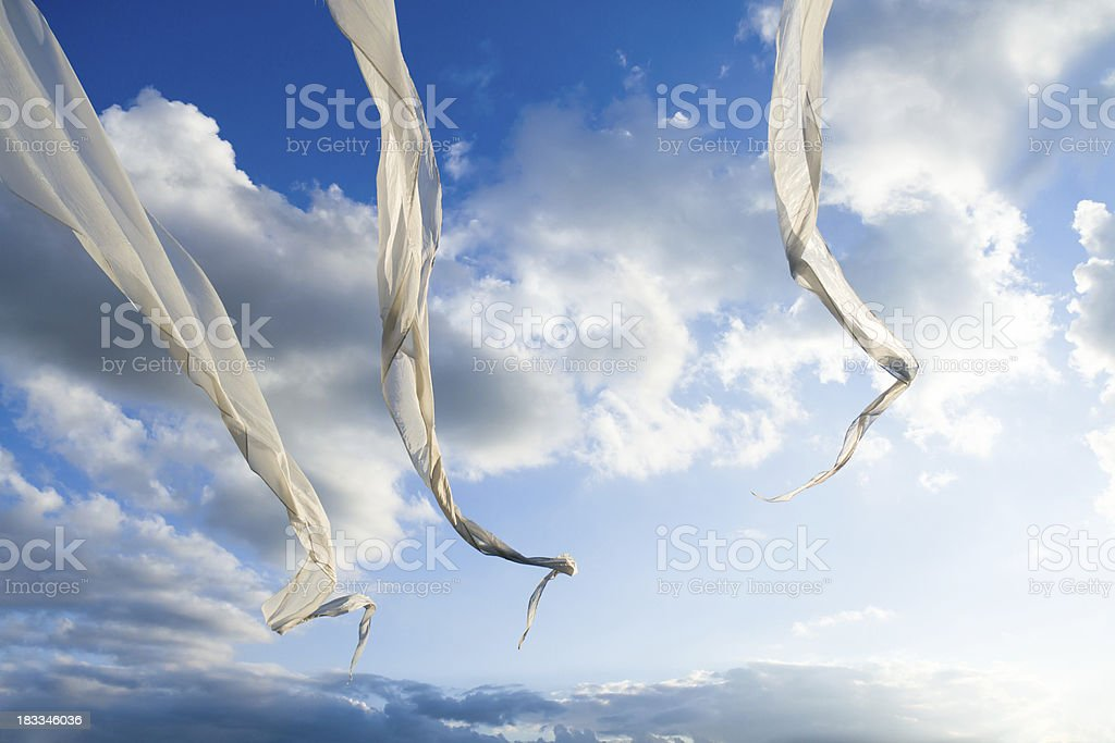 White Flags dancing in a sunny blue Sky royalty-free stock photo