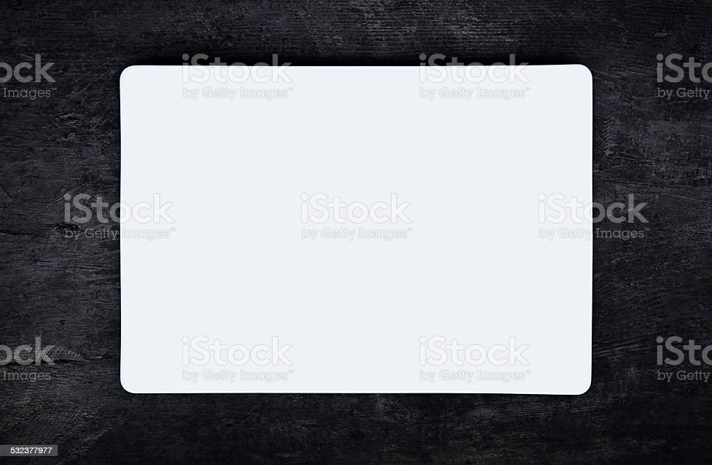 White flat plate on dark wooden table stock photo