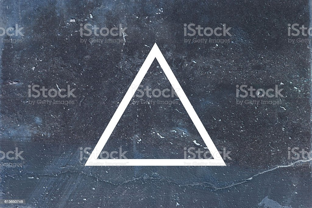 White flat triangle on abstract stone background. stock photo