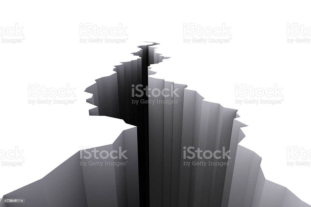 White floor with large black crack going through it stock photo