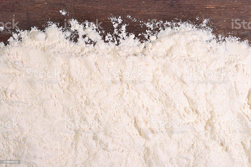 White flour on a wooden background stock photo