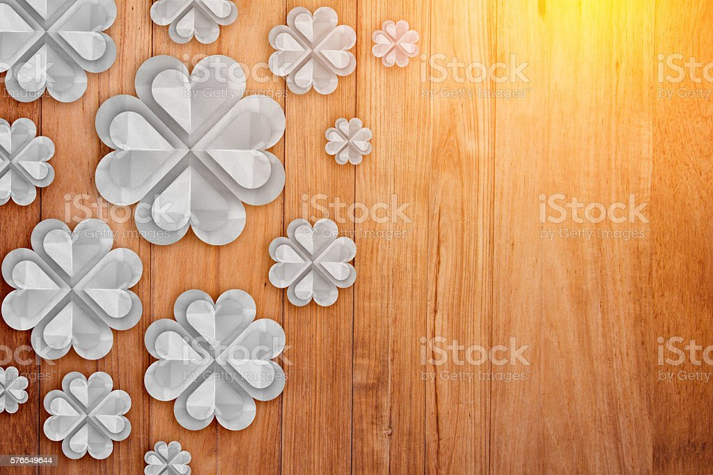 white flower paper cut on wooden plank background stock photo