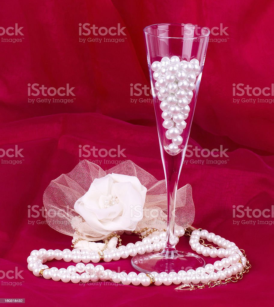 White flower, pearls and beads royalty-free stock photo