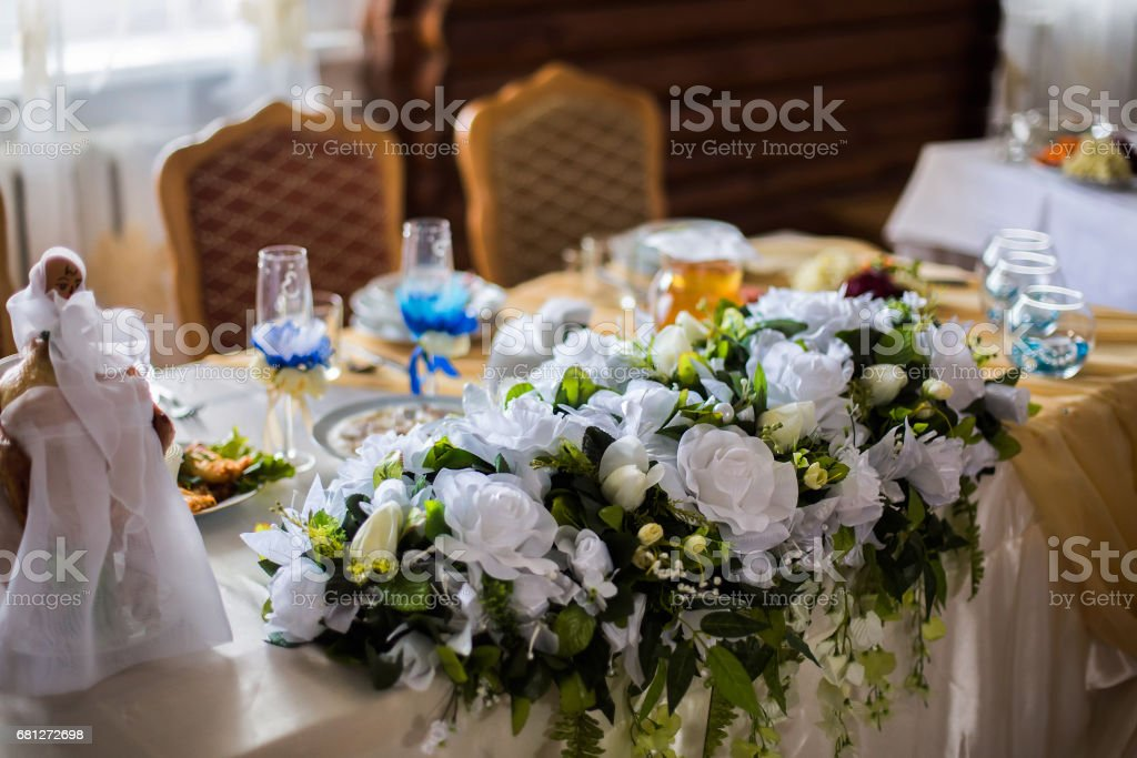 white flowers, wedding accessories, wedding preparation, decorated wedding table with flowers, wedding flowers, food on the table, decorated chairs, table and chairs, glasses, fruit, grapes, salad on the table stock photo