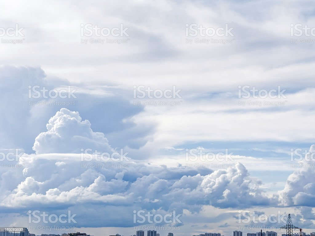 White fluffy cloud in blue sky background over skyline royalty-free stock photo
