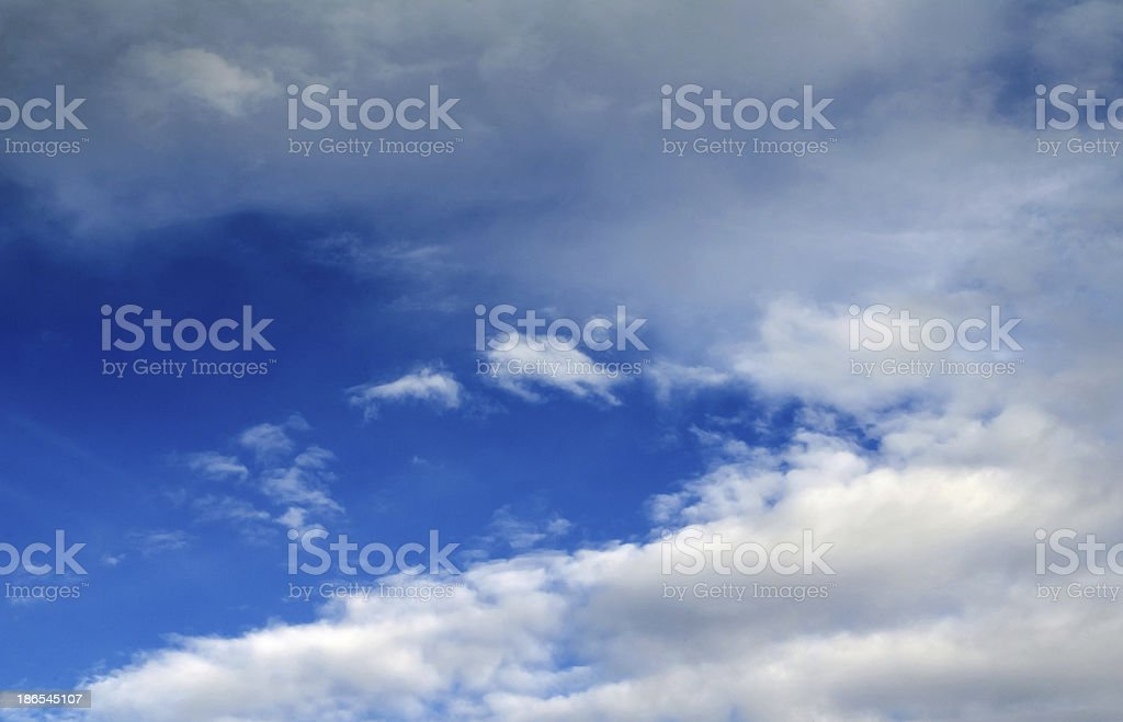 white fluffy clouds in the blue sky royalty-free stock photo