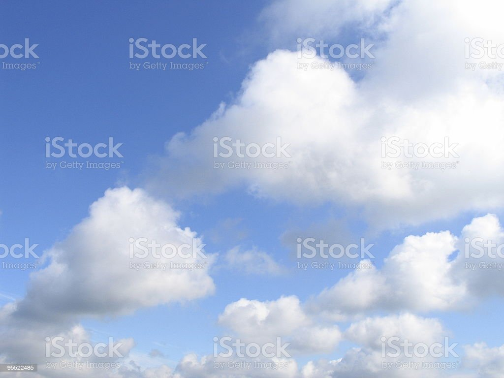 White, fluffy clouds on a sunny day royalty-free stock photo