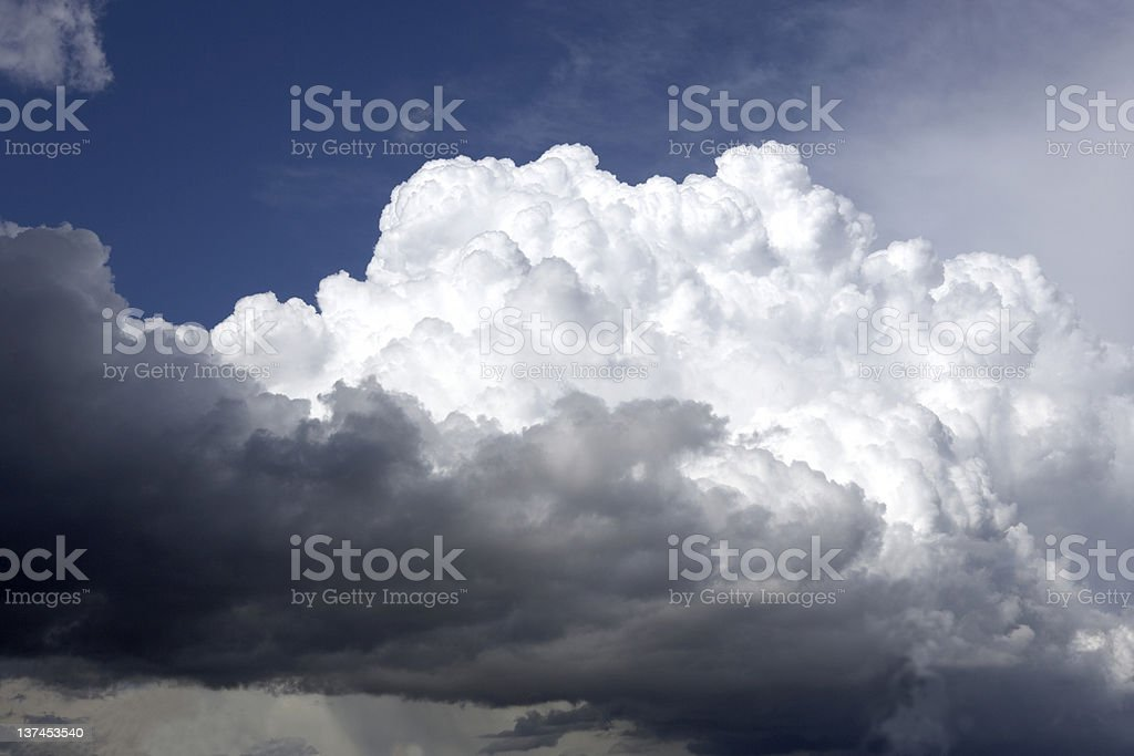 White Fluffy Clouds over the Storm ! stock photo