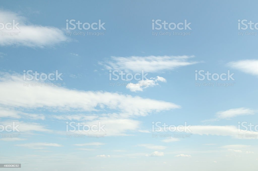 white fluffy clouds stock photo