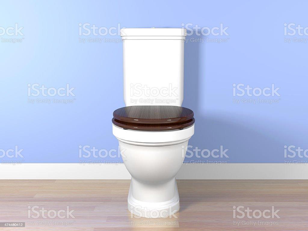 White flush toilet in a bathroom stock photo