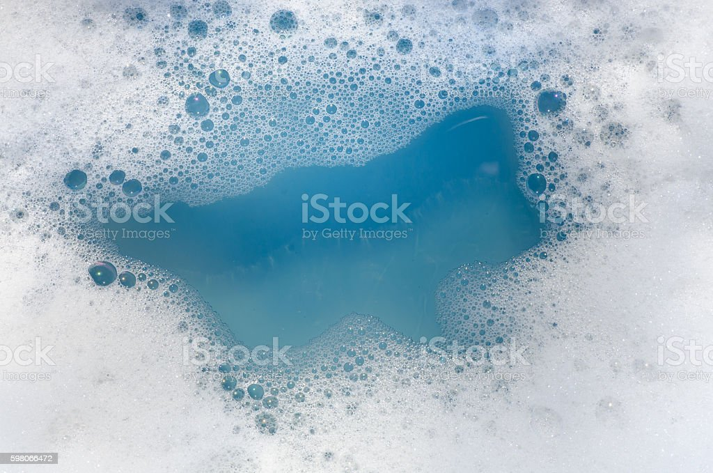 white foam on blue water stock photo