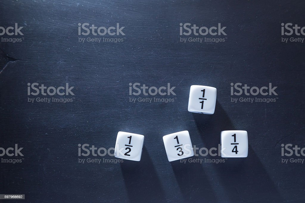 white fraction math number dices on blackboard stock photo