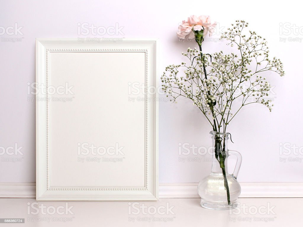 White frame mockup with flowers. stock photo