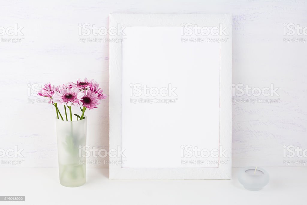 White frame mockup with lilac daisies stock photo