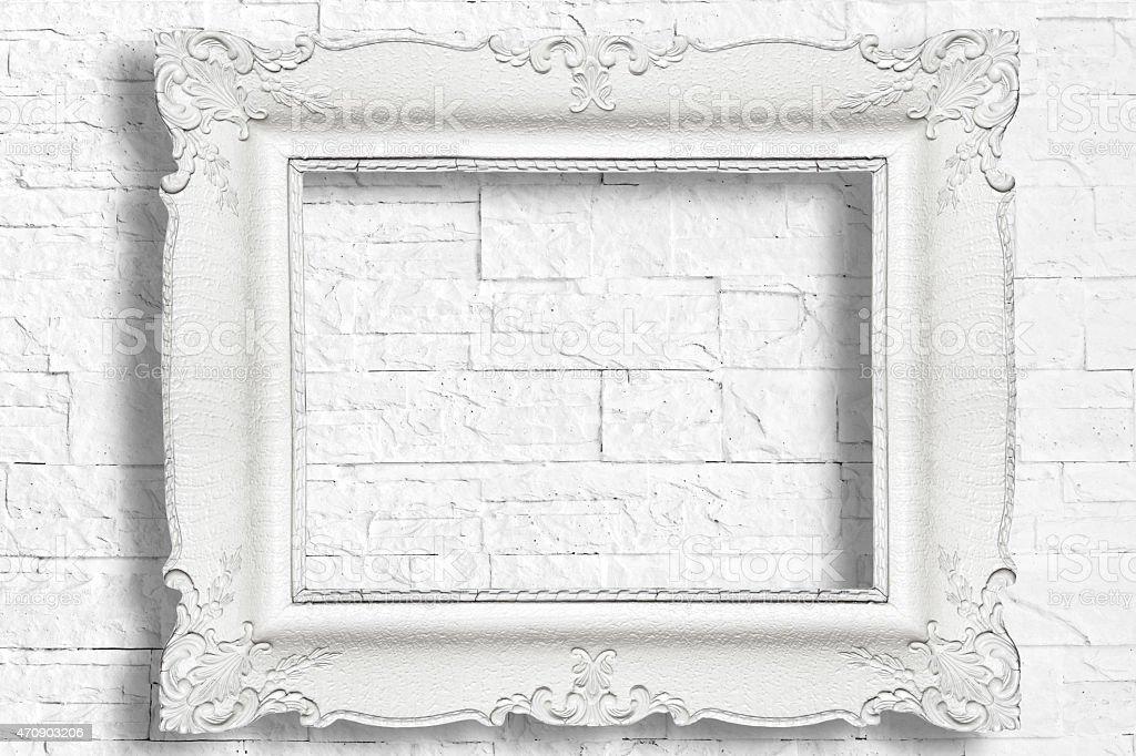 White frame on brick wall stock photo