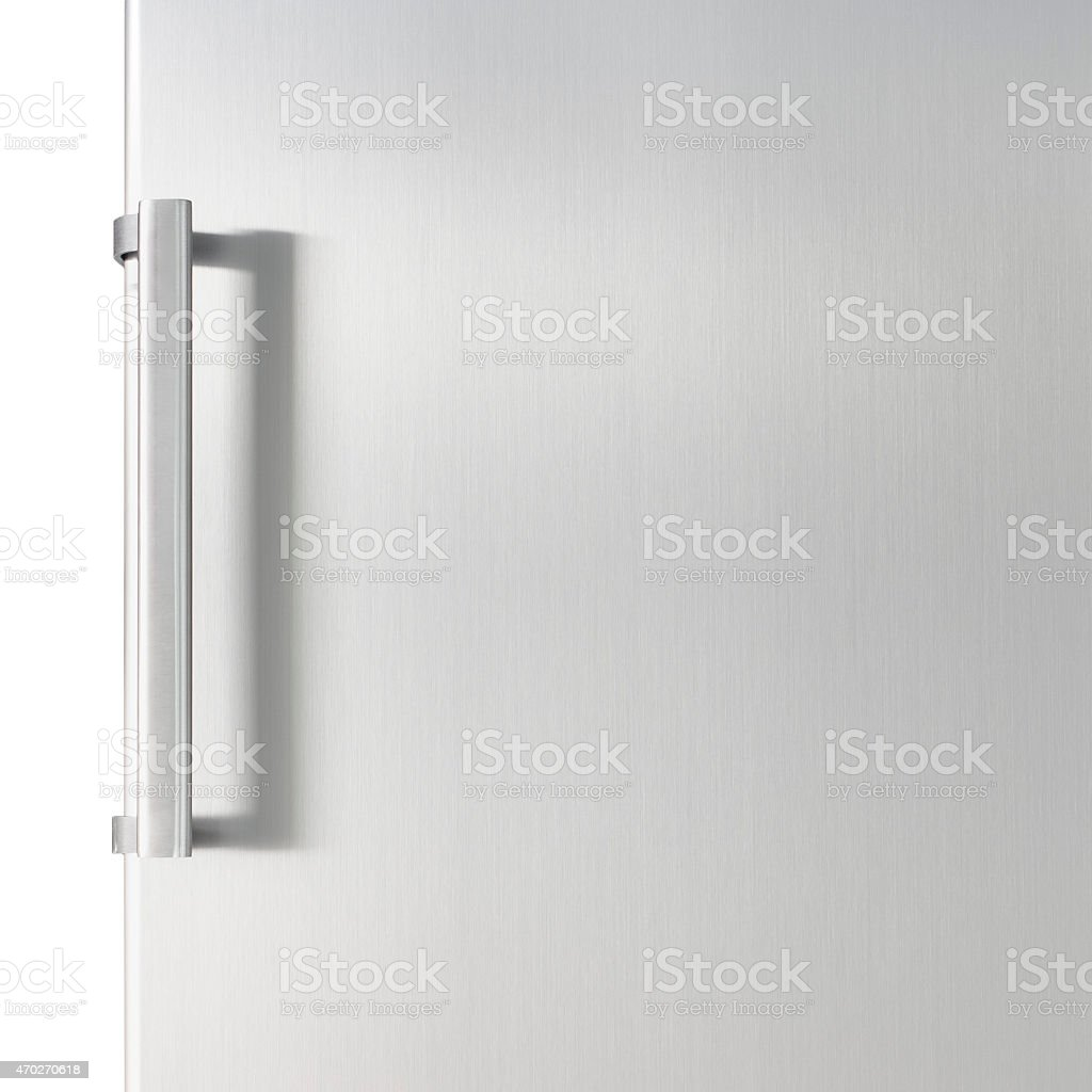 White fridge door with a silver handle stock photo