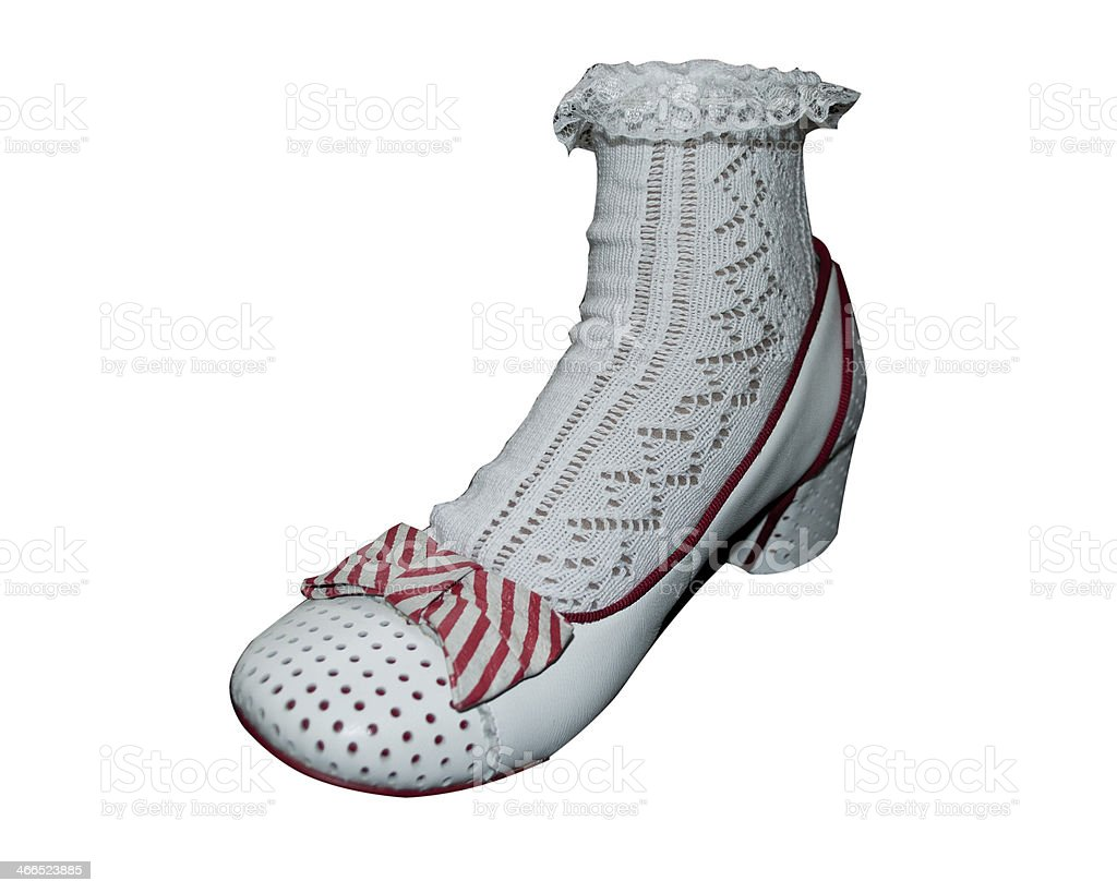 White Frilly Sock And White Shoe stock photo