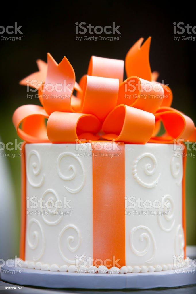 White Frosted Cake with Orange Marzapan Bow royalty-free stock photo