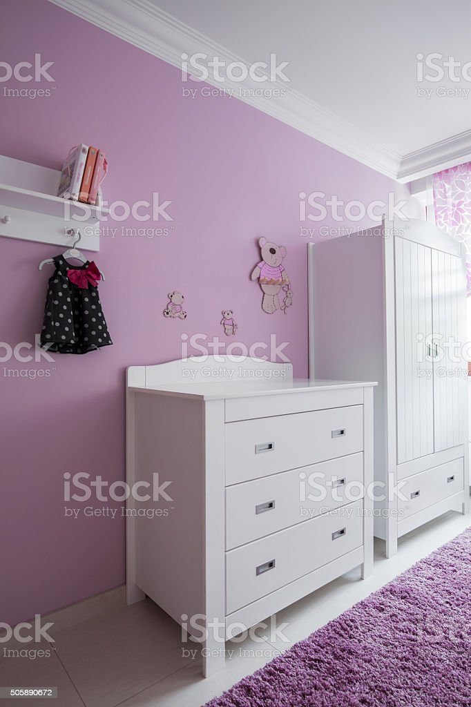 White furniture in baby's room stock photo