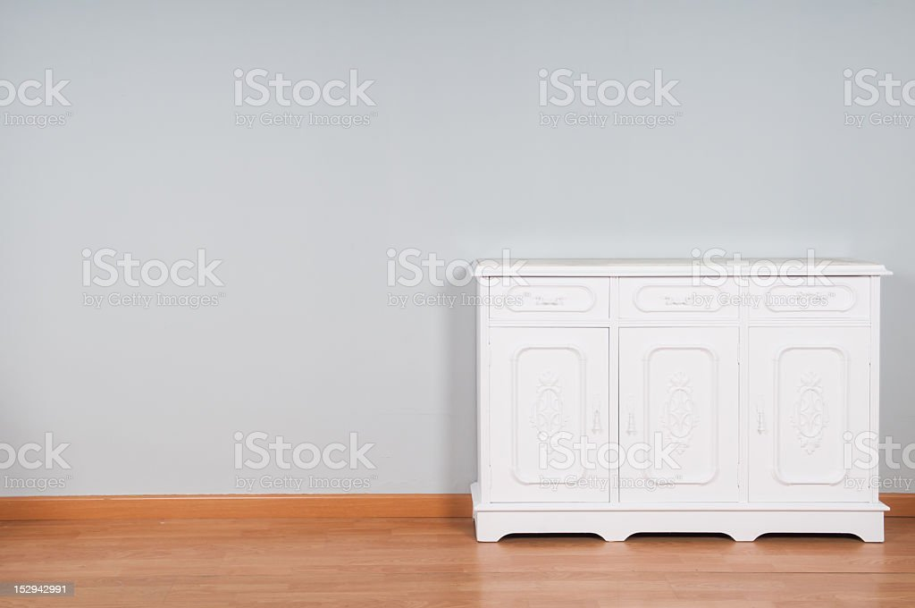 White furniture on gray background royalty-free stock photo
