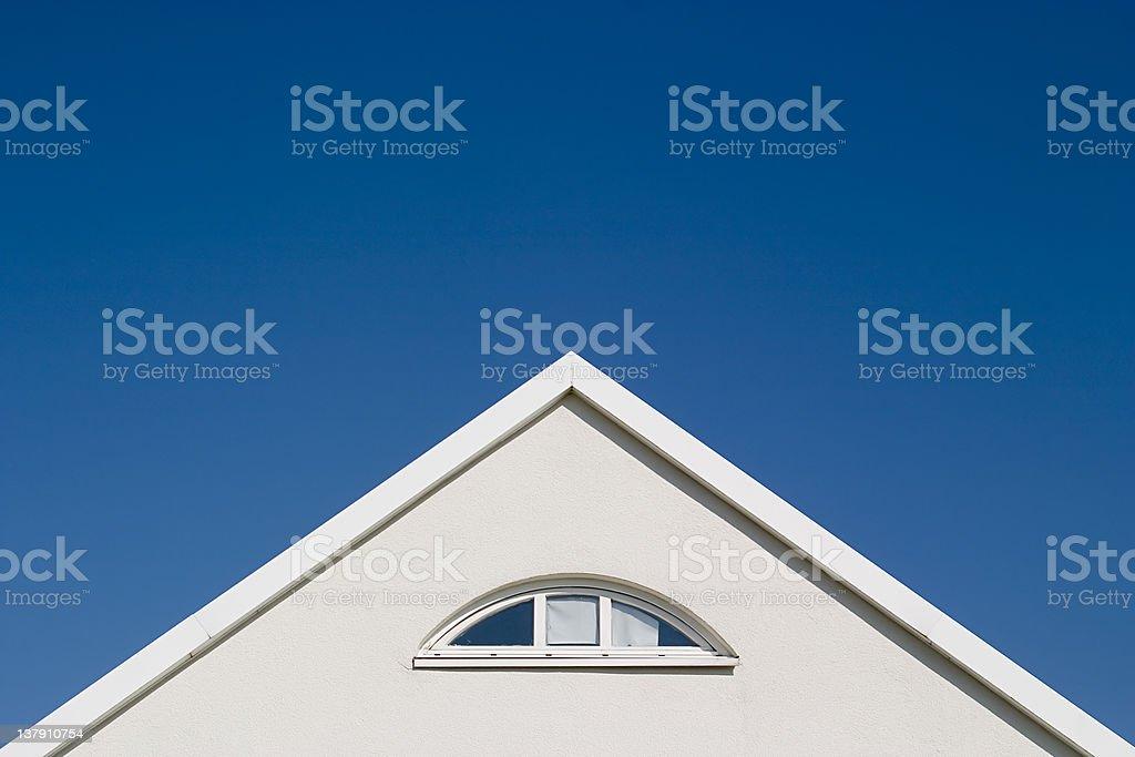 White gable - blue sky royalty-free stock photo