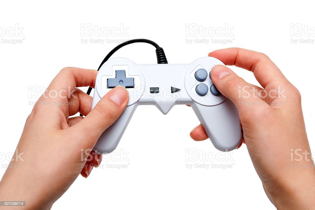 White game controller in hands stock photo