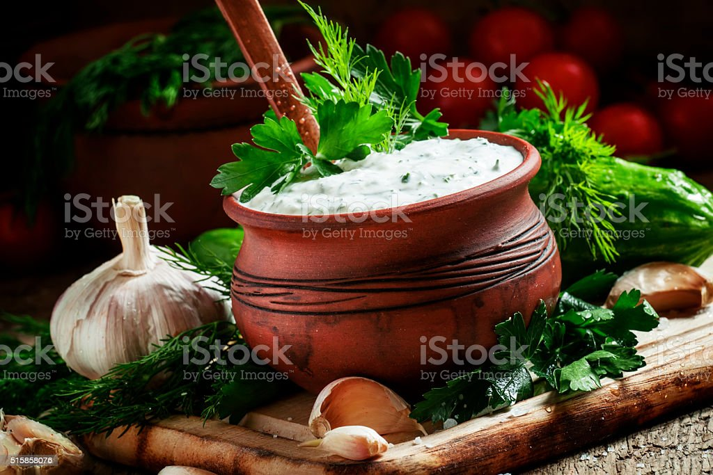 White garlic sauce, pottery tableware, country style stock photo